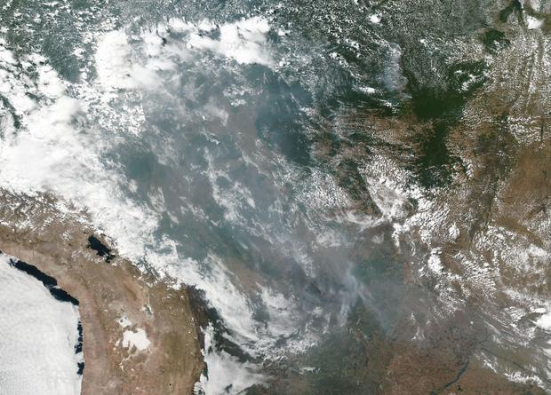 Satellite images show smoke from the Amazon reaching across the Latin American continent to the Atlantic coast and Sao Paulo, Brazil's biggest city Photo: Nasa/PA