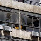 The building in Beirut housing Hezbollah's media office which suffered minor damage (Bilal Hussein/AP)