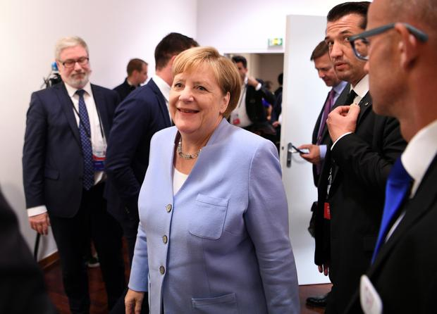 Talks: Angela Merkel plans to meet after fires have been put out. Photo: Andrew Parsons/Pool via REUTERS