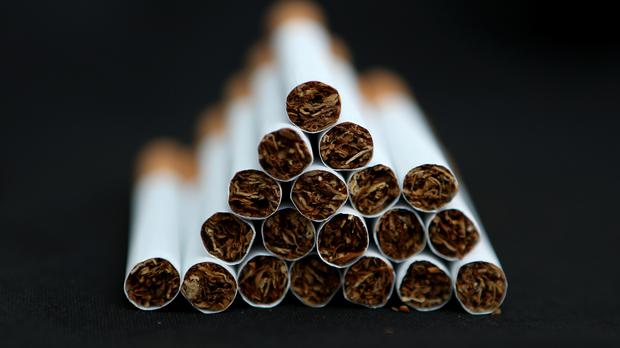 Tobacco giants Philip Morris International and Altria are in merger talks (PA)