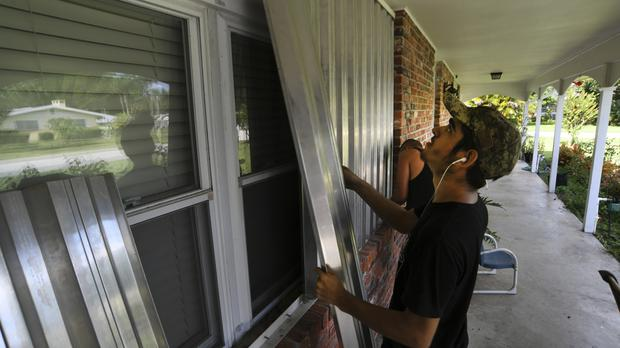 Residents in Florida prepare their houses for the arrival of Hurricane Dorian (Eric Hasert/TCPalm.com via AP)