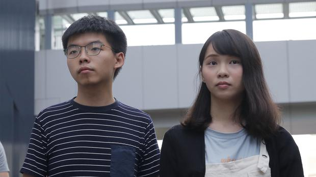 Joshua Wong and Agnes Chow, pictured in June, were both arrested on Friday (Kin Cheung/AP)