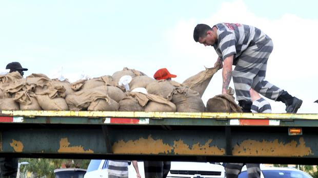 Brevard County prepares for the approach of Hurricane Dorian, as well over 100 vehicles lined up at 10:00am for free sandbags being filled by trustees from the Brevard County Jail (Florida Today/AP)