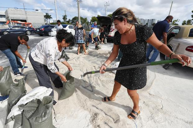 Residents fill sandbags in preparation for the storm in Florida (AP)