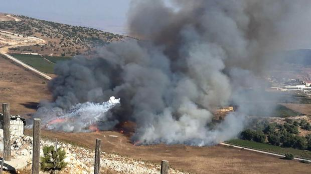 Smoke rises from Israeli army shells that landed in the southern Lebanese border village of Maroun (AP)