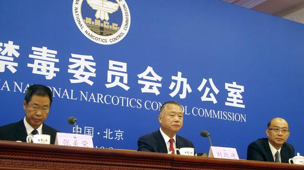 Liu Yuejin (centre), vice commissioner of China's National Narcotics Control Commission, speaks during a press conference in Beijing (Sam McNeil/AP)