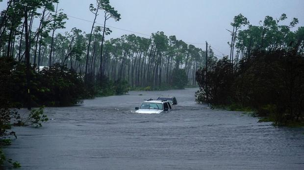A car sits submerged in water from Hurricane Dorian in Freeport, Bahamas (AP Photo/Ramon Espinosa)