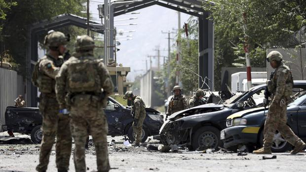 Resolute Support forces arrive at the site of a car bomb explosion in Kabul, Afghanistan (Rahmat Gul/AP)