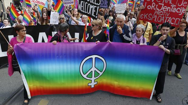 Participants march during Bosnia's first ever LGBT Pride parade in Sarajevo (Darko Bandic/AP)