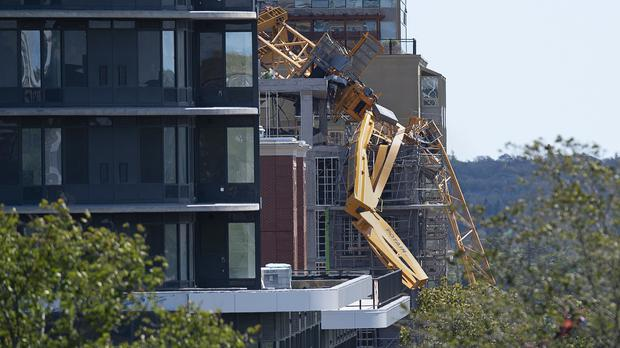 The twisted remains of a building crane hang off a construction project in Halifax Nova Scotia in the wake of Dorian (Andrew Vaughan/AP)