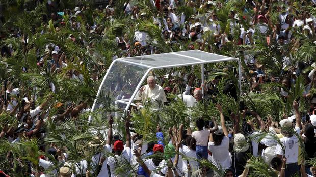 Pope Francis arrives to celebrate mass at the Monument Mary Queen of Peace, in Port Louis, Mauritius (Alessandra Tarantino/AP)