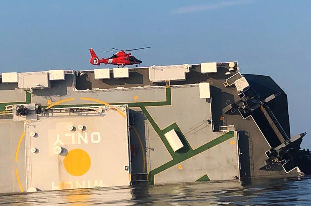 Rescuers contact men trapped deep inside capsized cargo ship