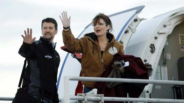 Then Republican vice presidential candidate Alaska governor Sarah Palin and her husband Todd wave as they leave the Ted Stevens Anchorage International Airport in Anchorage (Ted S. Warren/AP)