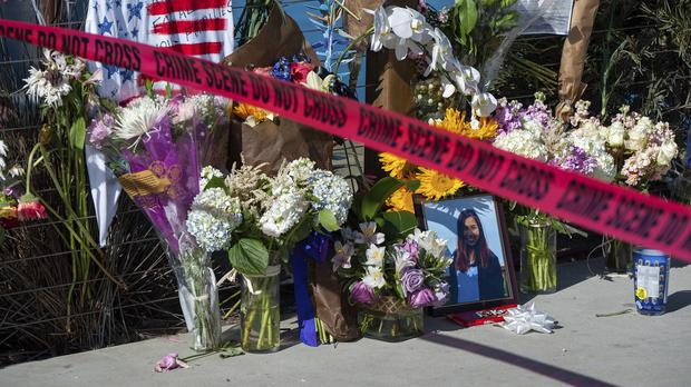 Red crime scene tape is placed by a memorial for the victims of the Conception dive boat fire (Christian Monterrosa/AP)