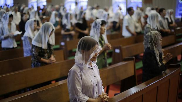 Catholics offer prayers at an early morning mass to pay respect to the victims of the atomic bombing at the Urakami Cathedral in Nagasaki, southern Japan (Eugene Hoshiko/AP)