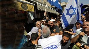 Supporters of rival political parties scuffle during an election campaign in the market in Jerusalem. Photo: Ammar Awad/Reuters