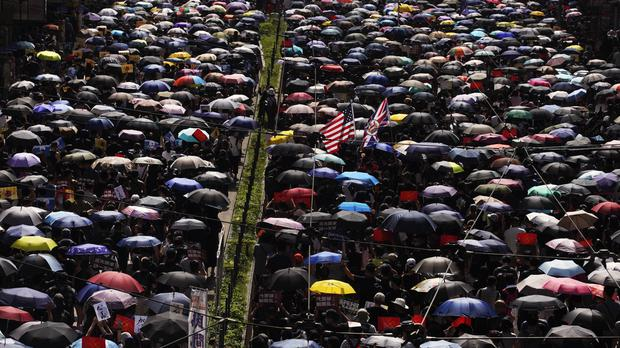 Protesters carrying umbrellas take part in march in Hong Kong (Vincent Yu/AP)