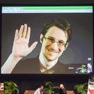 Edward Snowden appears on a live video feed broadcast from Moscow (Marco Garcia/AP)