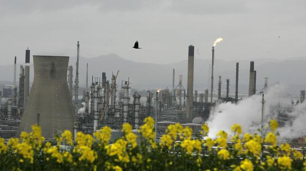 An oil refinery with its gas flare shining (PA)