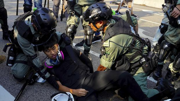 Police detain a protester in Hong Kong (AP/Vincent Yu)