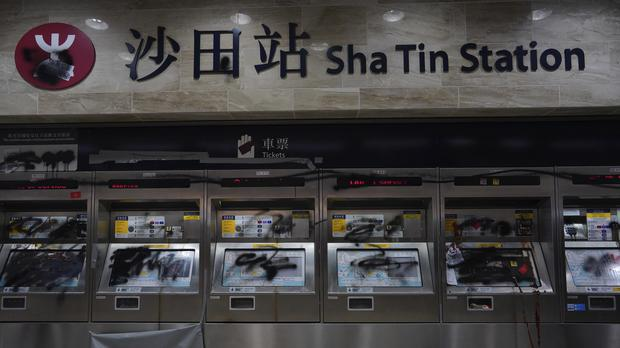 Ticket machines damaged by protesters are seen at a subway station in Hong Kong (Vincent Yu/AP)