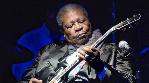BB King playing a black Gibson ES-345 prototype that was one of several guitars he called Lucille (Richard Drew/AP)