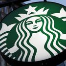 A Starbucks sign outside a coffee shop (Gene J. Puskar/AP)