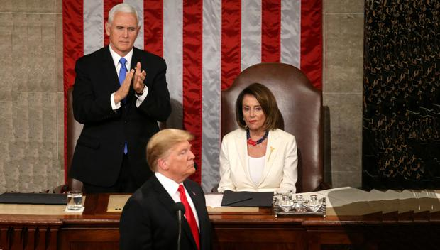 THE CLOSING ACT? US Speaker Nancy Pelosi reacts alongside vice-president Mike Pence as he applauds Donald Trump during his State of the Union address on Capitol Hill last February. Photo: Reuters