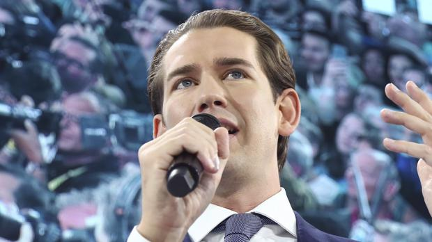 Former Austrian chancellor and top candidate of the Austrian People's Party, OEVP, Sebastian Kurz talks to his supporters (Matthias Schrader/AP)