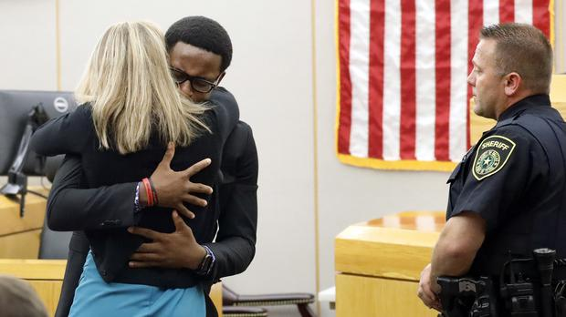 Botham Jean's younger brother Brandt Jean hugs convicted murderer and former Dallas Police Officer Amber Guyger (Tom Fox/AP)