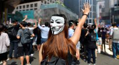 Anger: A woman wearing a mask takes part in a protest against the anti-mask law in Hong Kong yesterday. Photo: Getty
