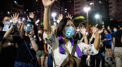 Masked protesters return to the streets of Hong Kong. Photo: Getty Images