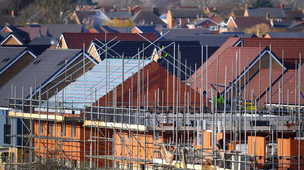Construction supplier SIG saw shares slide after it said a downturn in the UK and German construction sectors had hit profits (PA)