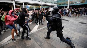 Backlash: Protesters clash with police as they demonstrate at the airport, after Catalan leader were jailed. Photo: REUTERS/Albert Gea