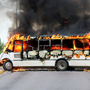 Mayhem: A bus set alight by cartel gunmen in Sinaloa state, Mexico. Photo: Reuters
