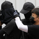 Covered: Anti-government protesters in masks. Photo: Reuters