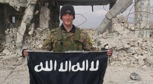 HEVAL: Joshua Molloy with a captured Isil flag