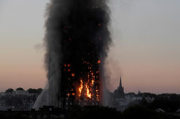 Tragedy: Flames and smoke billow as firefighters deal with the blaze in the Grenfell Tower apartment block. Photo: Reuters/Toby Melville/File Photo