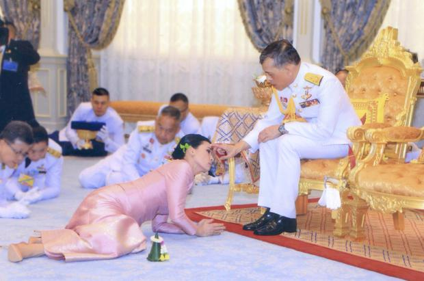 Monarch: King Maha and with one of his consorts, named Queen Suthida, at their wedding ceremony in Bangkok in May. Photo: Thai Royal Household