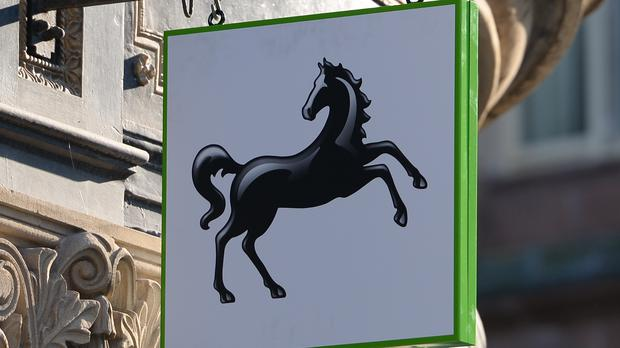 Lloyds pre-tax profits fall 97% after £1.8bn PPI charge