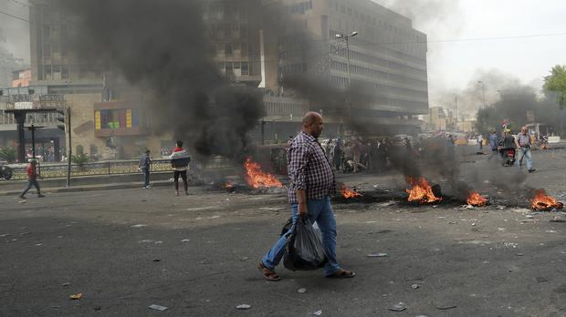 3 protesters killed in clashes as Iraq tries to reopen port
