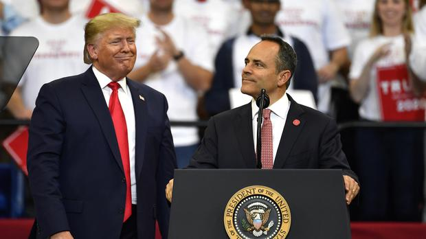Kentucky Governor Matt Bevin, right, looks out at the crowd as President Donald Trump watches during a campaign rally (Timothy D. Easley/AP)