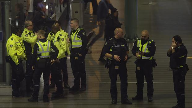 Dutch police massed at the airport (Peter Dejong/AP)