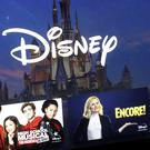 A Disney logo forms part of a menu for the Disney Plus movie and entertainment streaming service on a computer screen (Steven Senne/AP)