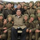 Kim Jong Un poses with North Korean soldiers (Korean Central News Agency/Korea News Service via AP)
