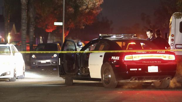 Police at the scene of the shooting (Larry Valenzuela/The Fresno Bee via AP)/The Fresno Bee via AP)