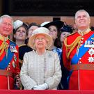 Andrew with the Queen and brother Prince Charles (left)