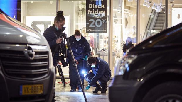 Forensic experts look for clues at the scene of the incident in The Hague (Phil Nijhuis/AP)