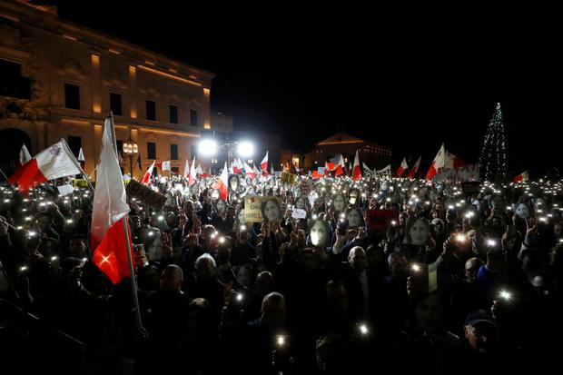 Malta's ruling party lawmakers back embattled prime minister