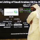 The stock market screen displaying Saudi Arabia's state-owned oil company Aramco (AP/Amr Nabil)